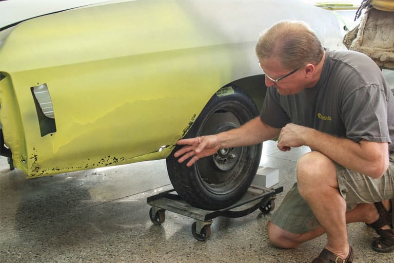 man looking at car for Car Restoration