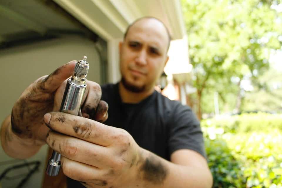 Man showing a spark plug