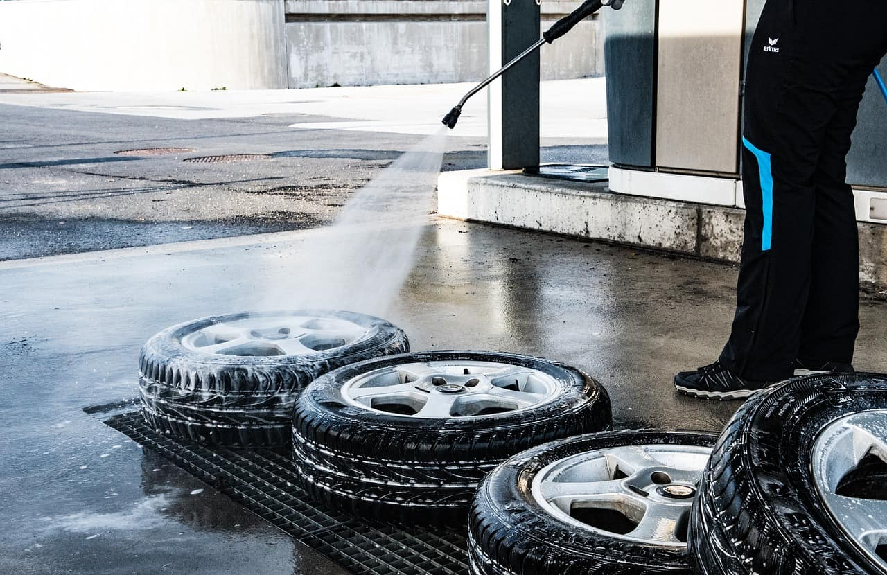 Man cleaning a bunch of tires